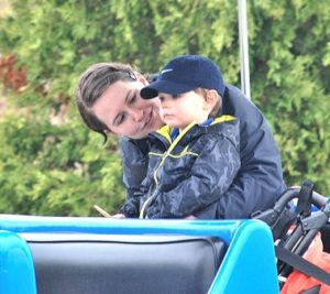 Nicole LeBlanc rides with her son, Maddox, 2, on the Roaming Railroad.
