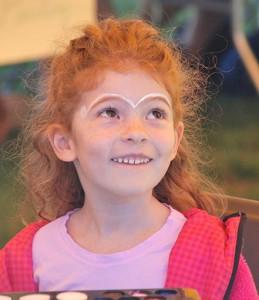 Juliana Parente, 5, sports painted eyebrows.