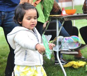 Reha Chaudhari, 2, waves a balloon wand at the Kids Carnival.