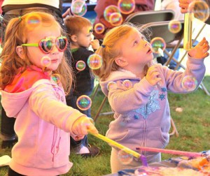 Emma McPherson, 3, and her sister Anna, 2, create and play with bubbles.
