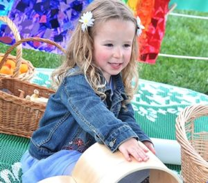 Ariana Dube, 4, stacks blocks at the Miss Tanya's Family of Nursery Schools booth.