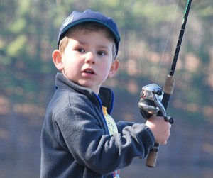 Christopher Lencioni, 4, waits to catch his second fish at the Westborough Civic Club's Fishing Challenge.