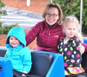 Michele Duke (center) rides the Roaming Railroad with daughters Holland, 3, and Summer, 5.
