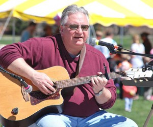 Tom Potosnak entertains at the Music Fest. That evening, he performed a benefit for In Your Shoes, a Westborough-based giving circle.