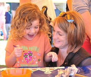 Tierney Murphy, 4, and her mom Courtney decorate a crown.