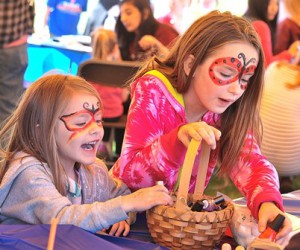 After getting their faces painted, Kaitlin Ziemba, 4, and her sister Abigail, 7, select their favorite nail polishes.