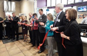 Surrounded by local and state officials, David Lockwood cuts the ribbon at the grand opening of his new Taco Bell.  Photo/Bonnie Adams