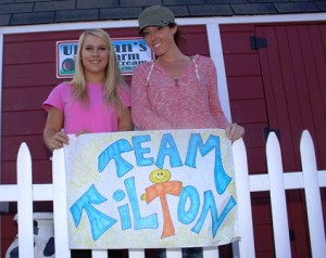 Michelle Tilton, right, with her manager Kelley Donley, on Monday, Sept. 24, at Uhlman's Ice Cream in Westborough. Tilton has raised thousands of dollars on behalf of her mother for brain tumor research, with the help of Uhlman's staff. Photo/John Swinconeck