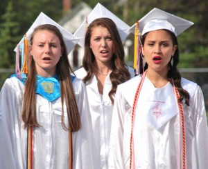"Molly Stone, Alli Raissipour and Irene Benites sing ""The Star-Spangled Banner."""