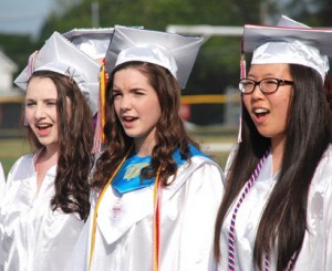 "Maddison Avergon, Susannah Speed and Heesun Jun sing ""The Star-Spangled Banner."""