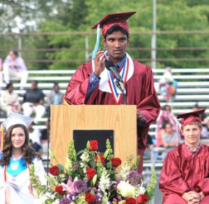 "Salutatorian Anuraag Gopaluni plays the song ""Anuraag"" into the microphone."