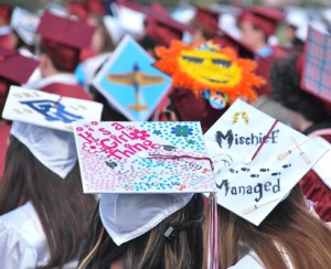 Graduates express themselves with decorated caps.