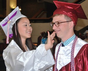 Vivian Ma wipes lipstick from Connor Hounslow's cheek.