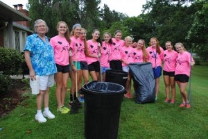 Ruggles Street homeowner, Rosetta Moore is thrilled to have members of the WHS field hockey team help with her yard. (Photo/submitted)