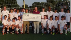 Westborough High School soccer players and team manager Dave Reynolds (left) receiving a donation check from Steve Hart, vice president, Westborough Civic Club. (Photo/submitted)
