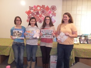 (l to r) Girl Scouts Christina Buffo, Margaret Baldwin, Ellen Waite, and Elizabeth Whalen help decorate the Holiday Gift Shop. (Photo/Bonnie Adams)