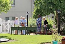 Westborough Garden Club members work on the outdoor garden at Whitney Place