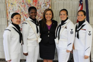 Women from the Navy Color Guard from the Quincy U.S. Naval Reserve Base stand proudly with Viviana Marcotte (center), Iraq War veteran and director of the Women's Veterans Network (WVN).