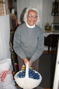 Lillian Grove holding a blueberry sculpture (Photos/Jane Keller Gordon)