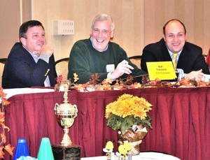 Sponsored by Ball Financial, (l to r) Selectmen Ian Johnson, George Barrette and Tim Dodd receive the trophy as trivia champs.