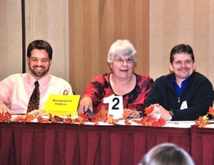 The Beaumont at Willows teammates (l to r) Mauro Ferreira, Nancy Fallon and Don Dumont are amused by the MC's comments.