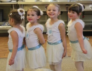 Snowflake dancers prepare to take the stage.