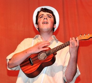 Before being crowned Mr. WHS, Pat Considine accompanies himself on ukulele while singing a medley of tunes.