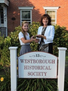 Philomena Feighan (right), treasurer of the Westborough Historical Society, presents a check to the society's 2014 scholarship winner, Hannah Schur, a recent graduate of Westborough High School. (Photo/submitted)