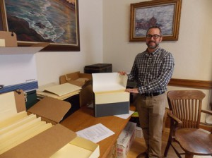 Westborough resident and archivist Tony Vaver with the boxes of historical documents he is in charge of organizing. (Photos/Valerie Franchi)