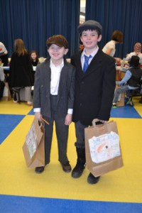 """Two students arrive at """"Ellis Island"""" with their belongings. (Photos/submitted)"""