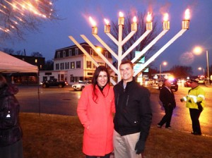Friends - and political rivals - Hannah Kane and Jason Palitsch - pose for a photo in front of the menorah. The two are both running for the state representative spot that will be vacated by  Matthew Beaton next month.
