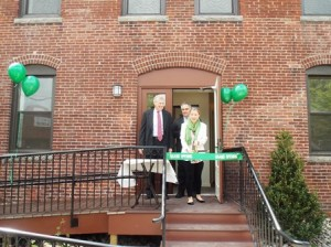 (l to r) Selectman George Barrette, state Rep. Danielle Gregoire, D-Marlborough, and Dean Calivas, COO of the Stonegate Development Group, celebrate the grand opening of Piccadilly Place.