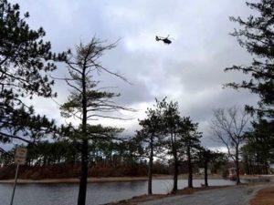 A Mass. State Police helicopter surveys Sandra Pond Reservoir. Photo/Bonnie Adams