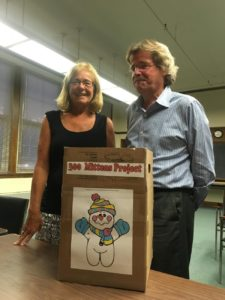 """Deborah Schradieck and Edward Newton Jr., co-chairs of the Westborough 300th Anniversary Committee, with a """"Snowman Mitten Box"""" for collecting mittens for the needy. (Photo/submitted)"""