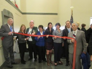 Officials gather for the ribbon cutting at Town Hall.
