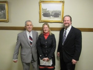 Robert Brown, chair, and Jessica Thomas, administrative assistant, Municipal Building Committee with Ed Turner, owner, ARt & Frame Emporium
