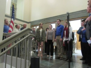 A choral group from Westborough High School sings the national anthem.