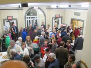 The crowd waits for the ceremony to start at Town Hall.