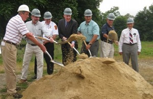 Town officials celebrate the ground breaking for the new fire station.