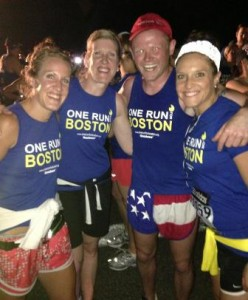 (l to r) Westborough gym teacher and coach Ali Rheaume, her mother Sue, race organizer Danny Bent from England, and her sister Jen, at the finish line of One Run for Boston on Boylston Street. Photo/submitted
