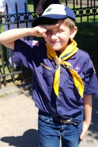 Cub Scout Gabe Zingher salutes the American flag at last year's Memorial Day Parade. Photo/submitted