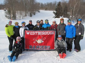 The Westborough High School state qualifying skiers and coaches are (l to r) Alexa Conlin, Taryn Israel, Alice Reh, Head Coach Greg Rota, Co-captain Robert Stout, Assistant Coach Andrew Lipke, Ryley Palladino, Co-captain Hanna Spofford, Dylan Connors, Reis Scerbin and Nicole Lipke. Seated are Sophia Bersani and Charlie Buress. Photo/submitted
