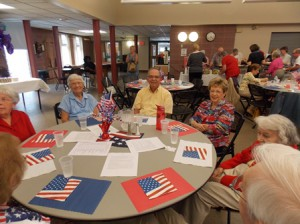 Cookout attendees, many dressed in red, white and blue to celebrate the holiday.