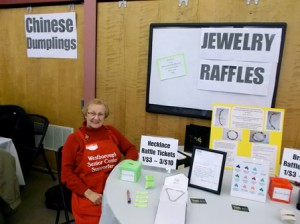 Linda, Westborough Senior Center Supporter, at the jewelry raffle table.
