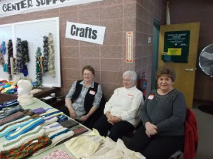 (l to r) Linda, Jeanette and Rita sell handmade crafts.