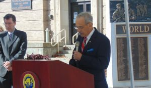 Alexander Tournas, the grand marshal, addressed the audience at the Forbes Municipal Building ceremony