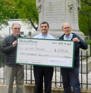 WVAB members John Gallinagh (left) and Kenneth Ferrera (right) with Joseph Mansour, president and CEO, MetroWest Community Federal Credit Union Photo/Bonnie Adams