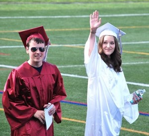 Patrick Considine and Isabelle Cunningham enter the football field.