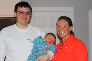 Adam and Ashley Orlando-Lohnes, with their son Carter, prepare to run the Boston Marathon for the Leukemia and Lymphoma Society. (Photo/submitted)