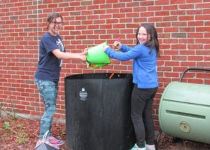 Zeh School fourth-graders Juliana Oyola and Siena Sciacca at the compost bins.